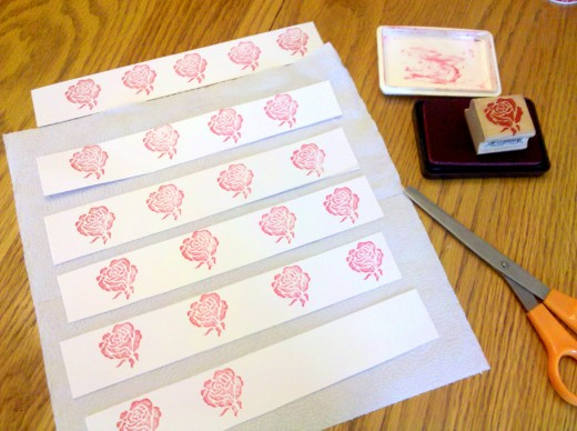 Stamp design on long strips of cardstock or construction paper.