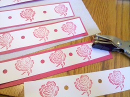 Punch holes in between the rose stamps.