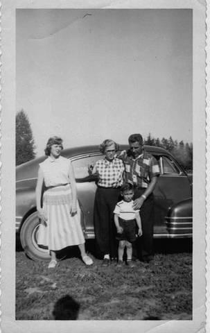 Mom, Dad, sister Darlys and me