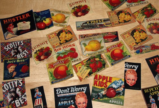 Fruit crate labels and vegetable crate labels which have been trimmed from sheets of decoupage paper.