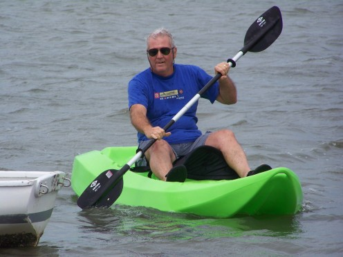 My dad tries out the kayak.