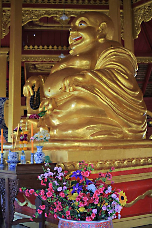 A smiling statue of the Buddha to be found in the Pavilion of the Enlightened shown earlier
