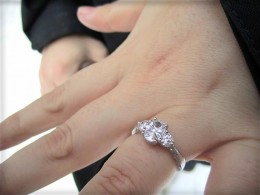 A white sapphire three-stone engagement ring