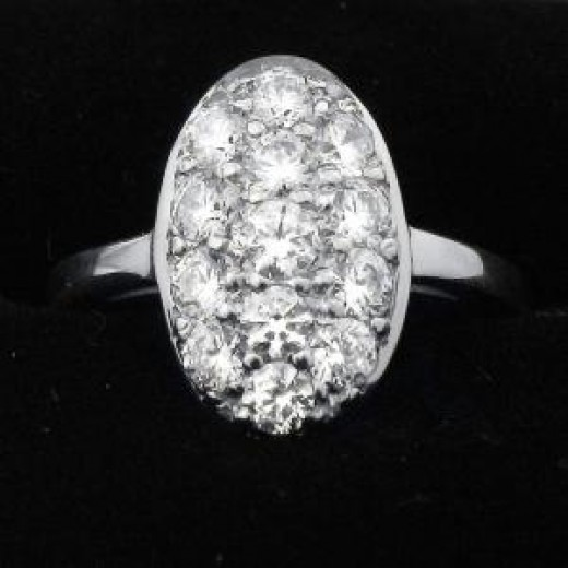 An imitation Twilight engagement ring-- Many tiny diamonds for far less than the price of one larger stone.