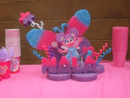 I did lots of research on Abby Cadabby centerpieces and did indeed find one to inspire me. As you can see, my styrofoam centerpiece that I airbrushed my self which took 2 days to dry, and assemble was the cutest thing on the table.