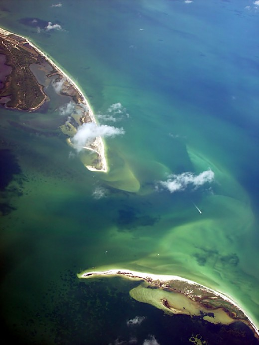 In this aerial view, Honeymoon Island is visible at the top of the picture with the northern tip of Caladesi Island at the bottom of the photo.  Originally a single island named Hog Island, it was split by the hurricane of 1921.