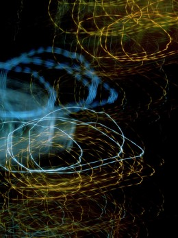 Strange attractor? by Kevin Dooley - a slow shutter speed combined with moving the camera in a circular motion produced abstract art from streetlights