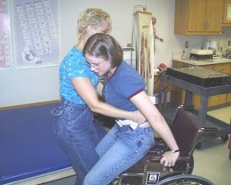 An occupational therapist assisting a disbled patient.