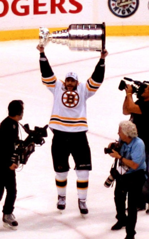 Boston Bruins forward Milan Lucic celebrates with the Stanley Cup after his team's Game 7 win against the Vancouver Canucks on June 15, 2011