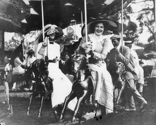 Public domain - copyright expired. See: http://en.wikipedia.org/wiki/File:On_the_Merry-go-round_at_Deepwater_Races_-_Deepwater,_NSW,_c._1910_G_Robertson-Cuninghame_from_The_State_Library_of_New_South_Wales.jpg