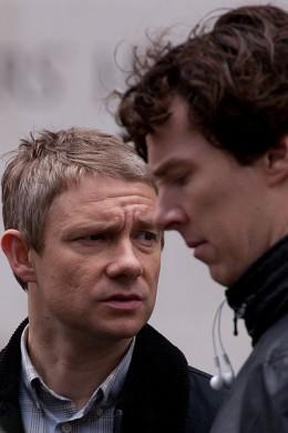 "Benedict Cumberbatch (profile) and Martin Freeman during filming of ""Sherlock"""