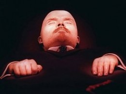 Lenin's trademark clenched right hand.