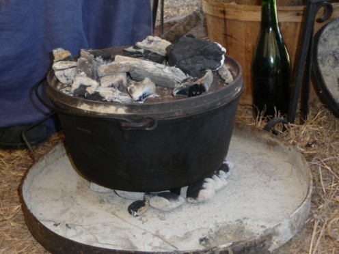 A CAST IRON DUTCH OVEN or Potjie.  Outdoor Cooking - meal with its two sources of heat.  On top of the lid and underneath the bottom.  See below Temperatures below