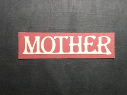 Mother adhered to rectangle
