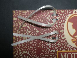 Ribbons laced to card