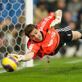 Casillas making a flying save.