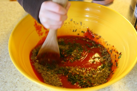 Stirring the sauce ingredients.