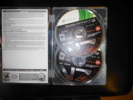 The inside of the metal case containing my two Mass Effect 3 discs