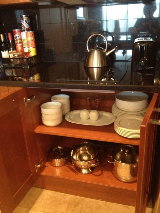 The Kitchen cabinets contained all the necessary cookware, dishes and small appliances to make a meal.