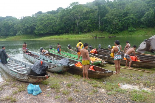 The Embera Indians waiting for us with their dug-out canoes in the rain.