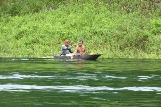 We pass by other native Indians paddling and fishing on the Chagres River.