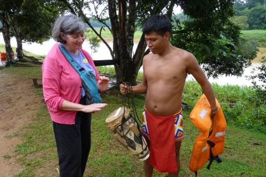 Marilyn trying out an Embera Indian drum.