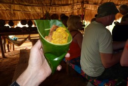 Our lunch - Fried Tilapia fish and fried plantain, served in a funnel shaped plantain leaf and pinned with a twig.