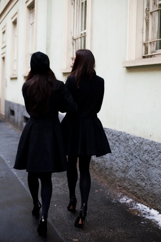 Two ladies on black coat