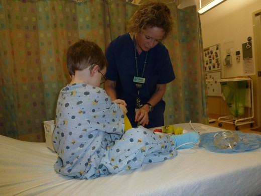 Child Life departments focus on the emotional well-being of the child. A child-life worker engages our son in a play-dough activity as he waits for surgery.
