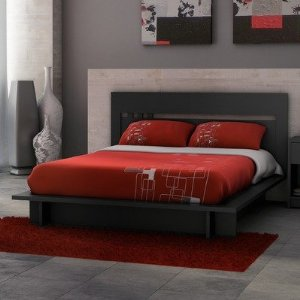A queen size platform bed in a solid black laminated finish.