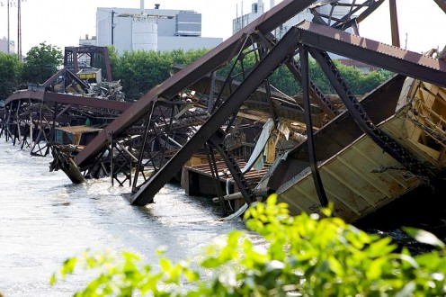 Cedar Rapids, Iowa, July 4, 2008 -- The railroad attempted to prevent this bridge from being pulled off it's pilings by weighing it down with train cars filled with gravel. In the face of the river's strength during the flood, the attempt was futile.