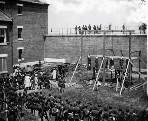 Building 20, the east wing of the first federal penitentiary, is at left. The gallows stand just east of current tennis courts.