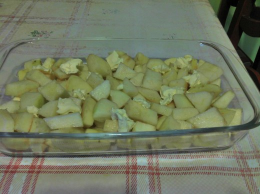 Apples in dish with chunks of butter