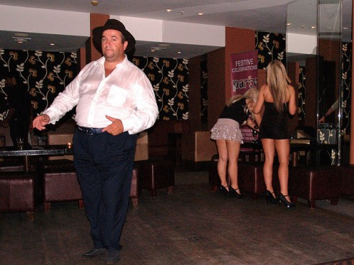 Fat guys CAN dance. And just gaze at the hot chicks in the background who are evidently waiting for him to finished with his dance solo.
