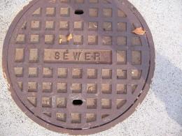 Manhole covers are round because the cannot fall or be dropped into the sewer conduit.