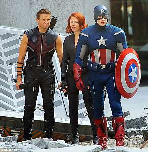 "Hawkeye (Jeremy Renner), Black Widow (Scarlett Johansson) and Captain America (Chris Evans) take on superpowered baddies in one of this summer's most anticipated movies, ""The Avengers"""