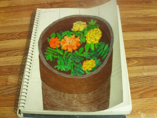 Here I have colored in the pot with a copper colored pencil