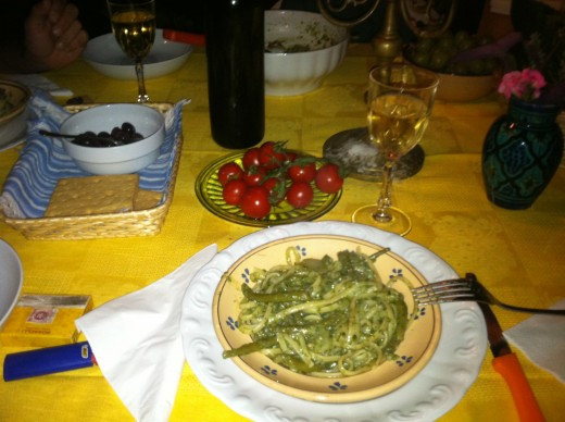 Pasta dinner with tomatoes and wine