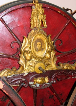 Enamel portrait on equipment in Friendship Firehouse
