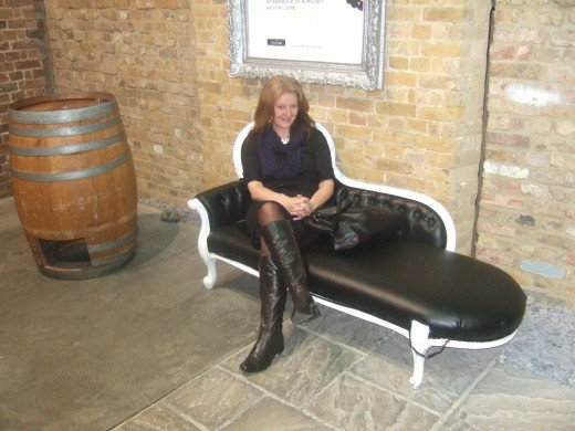 Wait for the wine tour on a chaise lounge.