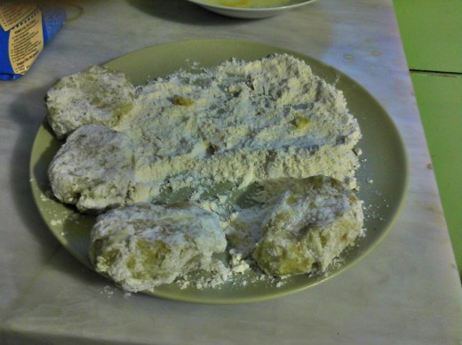 Floured cutlets ready for frying