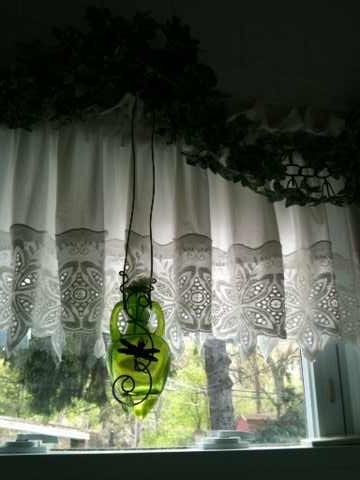 Craft festivals sell some amazing home-made glass hanging now. I hung this green dragonfly one in my bathroom window to add some accent color.