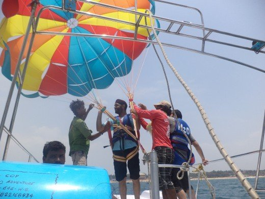 One of my friends from Punjab India getting ready for parasailing near Calangute Beach Goa. This ride costs 500 rupees for parasailing and the man on the boat offered two dips into the sea for just rupees 200. It was adventurous and thrilling.