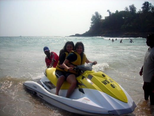 Two girls on a jet ski near Baga Beach in Goa.