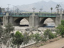Stone Bridge over Rimac River in Lima, Peru.