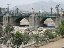 Stone Bridge over Rimac River in Lima, Peru.