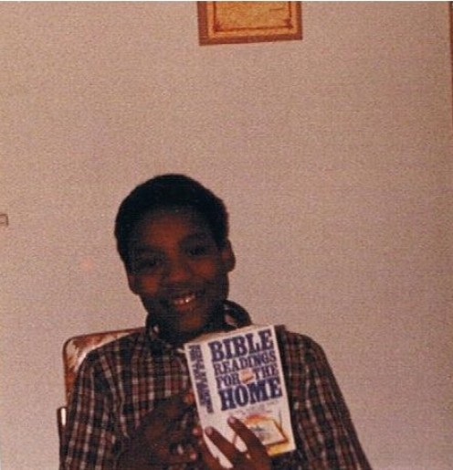 "Author in 1982 holding ""Bible Readings for the Home"" distributed by SDA."