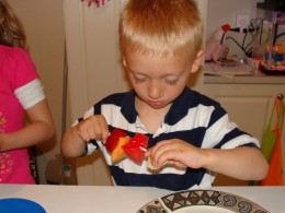 He concentrates very hard on his cooking!