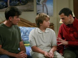 Charlie, Alan and Jake seemingly engrosed in a sensitive conversation on the Two and a Half Men show Season 5