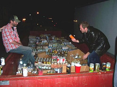 A dumpster FULL of sodas.
